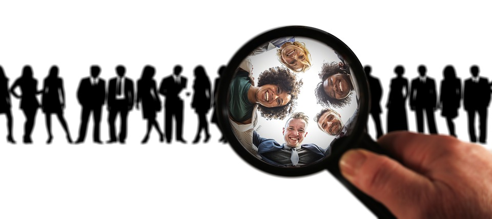 business clients as viewed through a magnifying glass